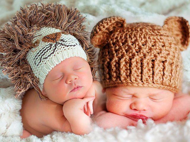 Шапочка для новонародженого спицями з описом і схемами